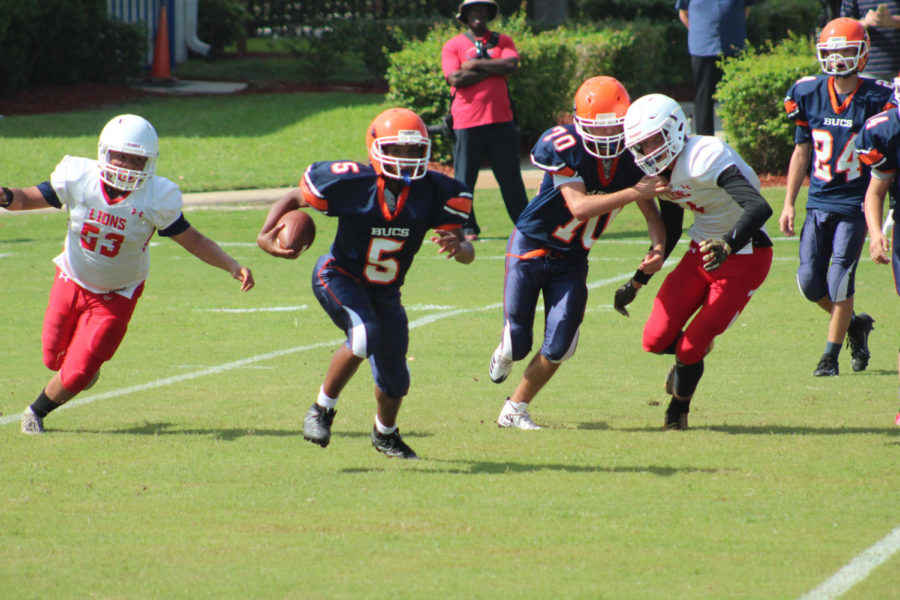 Ronnie Parson has the ball and is running towards the end zone.
