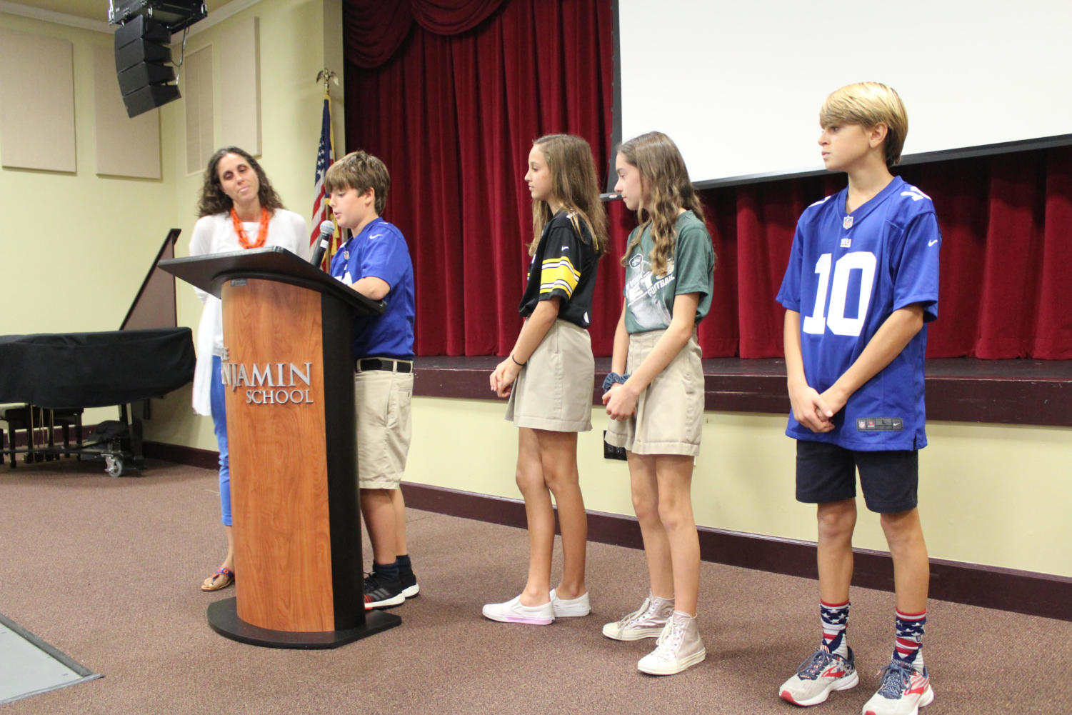 From left to right: Mrs. Benvenutto, Chester Coles, Maggie Smith, Emerson Ferry, and JP Walsh read about the importance of Red Ribbon Week.