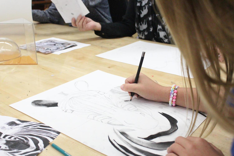 Scotto works on her zebra sketch.