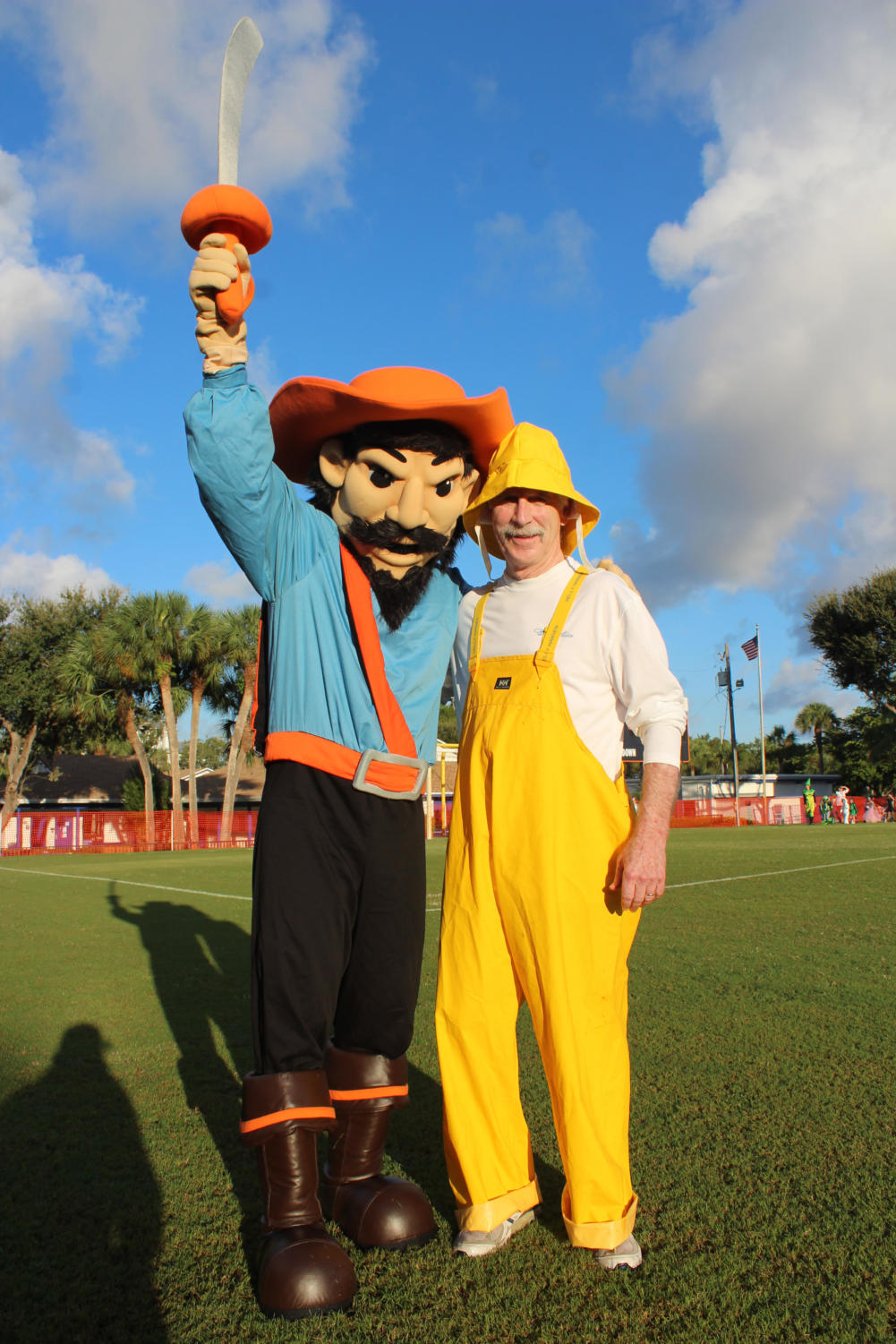 Mr. Reid and our mascot, the buccaneer, lead the Lower school halloween parade.