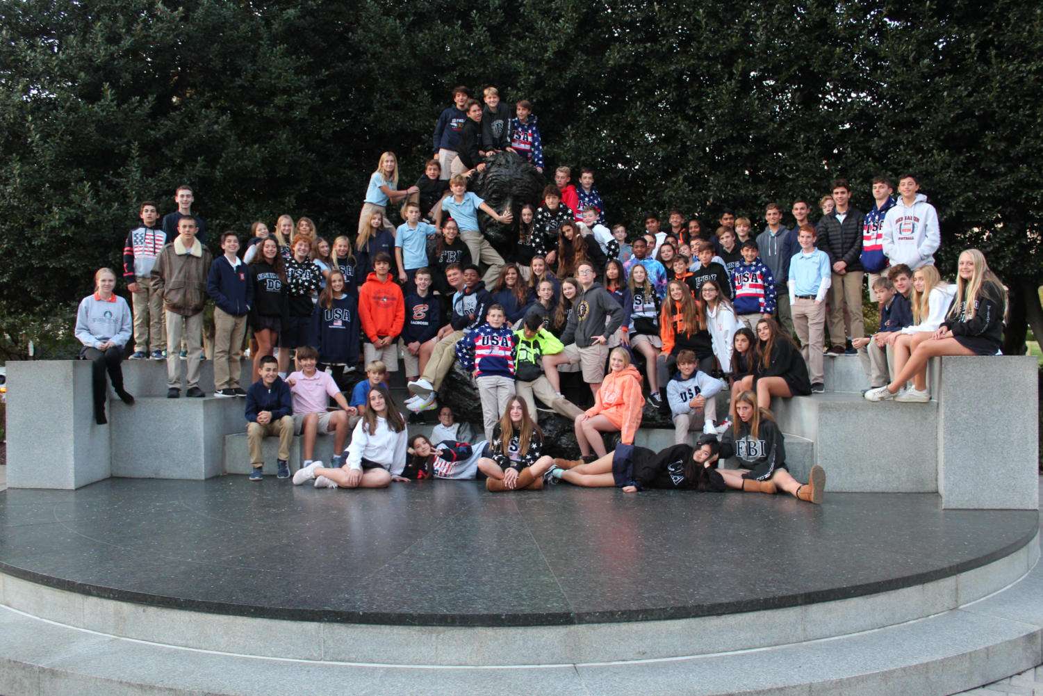 The eighth-grade poses in front of famous scientist Albert einstein.