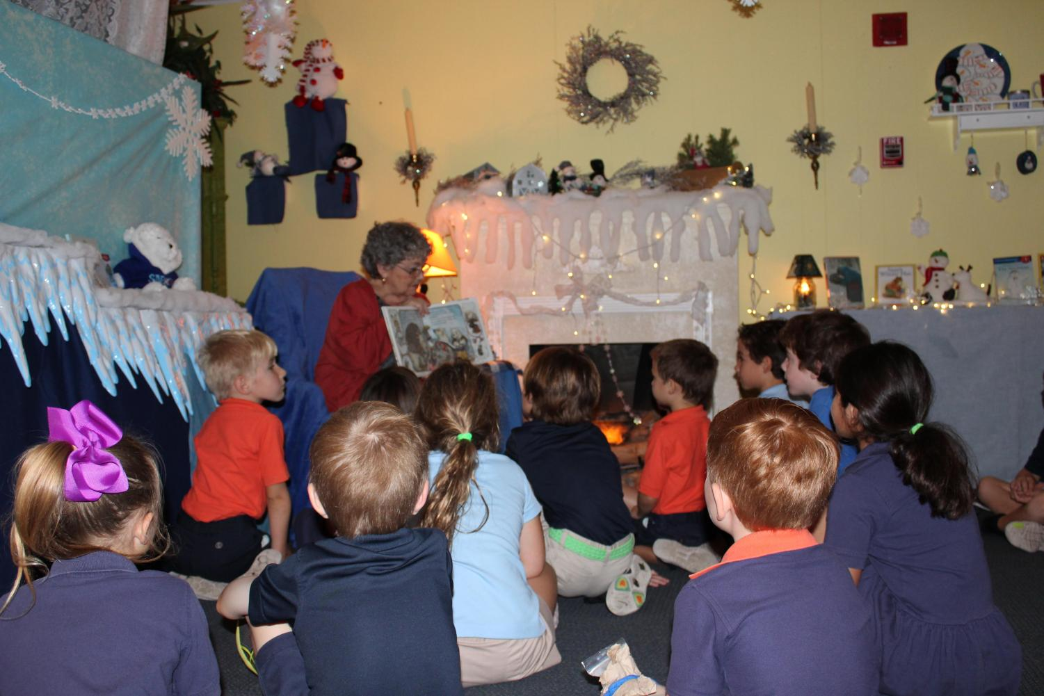 Mrs. Jane Higginbotham reads to her students in the story cottage.