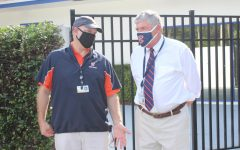 Head of Middle School Mr. Charles Hagy converses with Mr. Faus during the seventh-grade supplies pick up on August 14.