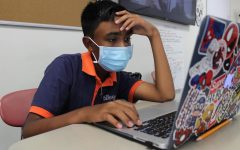 Seventh grader Dev Maharaj gets some homework done during ABC.