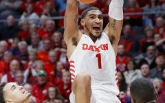 The star power forward from Dayton, Obi Toppin is dunking the ball. The Bulls really hope that he falls down to 5. (Image courtesy of www.registerguard.com)