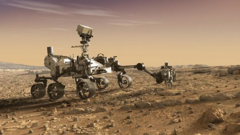 The Mars rover, Perseverance, uses its robotic arm in an artist
