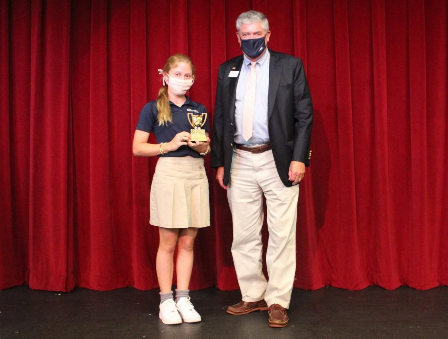 Vanessa Zito poses with Head of School Mr. Dave Faus on the BPAC stage after winning this year's bee.