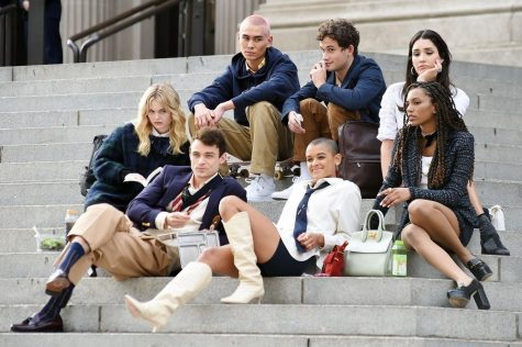 "The new cast of the ""Gossip Girl"" reboot poses on the famous ""Met steps"" in 2021: (left to right): Thomas Doherty, Eli Brown, Jordan Alexander, Emily Alyn, Lind, Whitney Peak, Zíon Moreno, and Evan Mock."