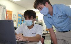 Eighth Graders Chester Coles and Darrow Becker following mask protocols while collaborating on an assignment in E Period History.