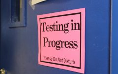 Signs are posted on classroom doors to ensure students have the best testing environment.