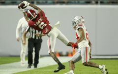 Alabama wide receiver Devonta Smith makes a n impressive sideline catch against Ohio State in the national championship game on January 11, 2021.