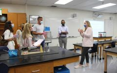 Eighth-grade science teacher Mrs. Stacy Schnurr speaks with a group of parents in her room on the evening of September 8.