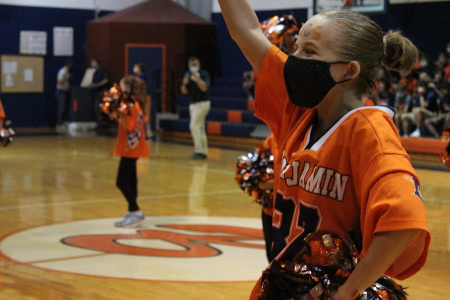 8th grader Bella Blount dances with the rest of the sparklers to BOOM, by X Ambassadors in the gym at the pep rally.